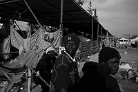 Tripoli, Libya, March 17, 2011.Thousands of refugees, mostly African and Egyptian workers stayed in very difficult conditions near Tripoli airport for many days, sometimes weeks, in the hope of a flight that would take them home. Today, less 1000 remain, mostly Ghaneans, but the imposition of the no-fly zone might make their return home impossible; they have no ressources, nowhere to go, and most of them are 'illegal' immigrants in Libya.