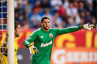 Columbus Crew goalkeeper Andy Gruenebaum (30) directs traffic on a corner kick. The New York Red Bulls and the Columbus Crew played to a 2-2 tie during a Major League Soccer (MLS) match at Red Bull Arena in Harrison, NJ, on May 26, 2013.