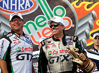 Oct 6, 2013; Mohnton, PA, USA; NHRA funny car driver John Force (right) celebrates with crew chief Jimmy Prock after winning the Auto Plus Nationals at Maple Grove Raceway. Mandatory Credit: Mark J. Rebilas-