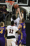 Louisville's Montrezi Harrell (24) is fouled by Northern Iowa State's Seth Tuttle (10) during the 2015 NCAA Division I Men's Basketball Championship's March 22, 2015 at the Key Arena in Seattle, Washington.  Louisville beat Northern Iowa State 66-53 to advance to the Sweet 16.  ©2015. Jim Bryant Photo. ALL RIGHTS RESERVED.