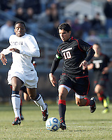 Northeastern University midfielder Andre Ciliotta (10) brings the ball forward. .NCAA Tournament. University of Connecticut (white) defeated Northeastern University (black), 1-0, at Morrone Stadium at University of Connecticut on November 18, 2012.