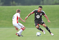 Dwayne De Rosario (7) of D.C. United goes against Scott Caldwell (6) of the New England Revolution. D.C. United defeated the The New England Revolution 3-1 in the Quarterfinals of Lamar Hunt U.S. Open Cup, at the Maryland SoccerPlex, Tuesday June 26 , 2013.