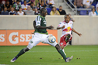 Dane Richards (19) of the New York Red Bulls is defended by Mamadou Danso (98) of the Portland Timbers. The New York Red Bulls defeated the Portland Timbers 2-0 during a Major League Soccer (MLS) match at Red Bull Arena in Harrison, NJ, on September 24, 2011.