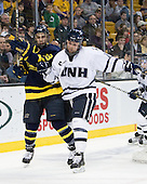 Mike Collins (Merrimack - 13), Paul Thompson (UNH - 17) - The Merrimack College Warriors defeated the University of New Hampshire Wildcats 4-1 (EN) in their Hockey East Semi-Final on Friday, March 18, 2011, at TD Garden in Boston, Massachusetts.