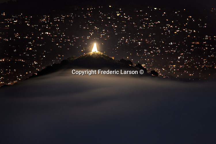 Seen from Marin to the east bay above the low lying fog an on top of Angel Island Christmas tree that shines bright every year around the holiday season. From dawn to dusk you can see the lone Angel Island Christmas tree as far the east bay to Marin county. ..