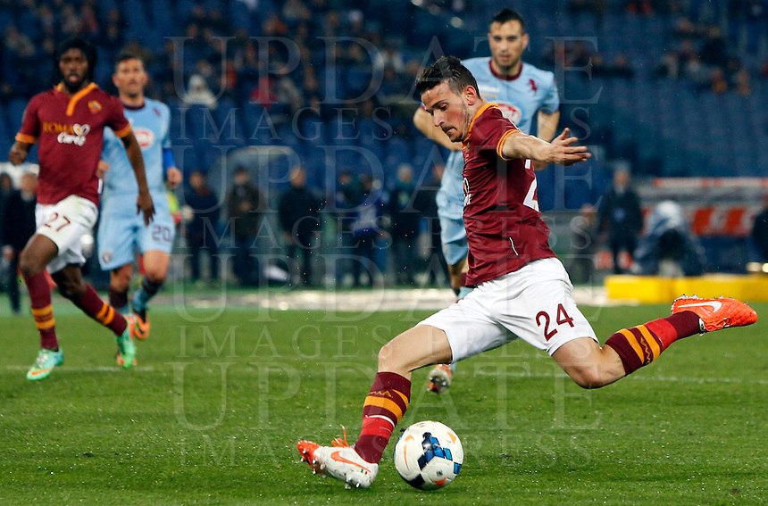 Calcio, Serie A: Roma vs Torino. Roma, stadio Olimpico, 25 marzo 2014.<br /> AS Roma midfielder Alessandro Florenzi kicks the ball to score the winning goal in the last minutes of the Italian Serie A football match between AS Roma and Torino at Rome's Olympic stadium, 25 March 2014. AS Roma won 2-1.<br /> UPDATE IMAGES PRESS/Riccardo De Luca