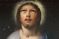 Detail of Christ, from painting of the Last Supper, 1615, by Philippe Hodart, in the Sao Miguel Chapel, or St Michael's Chapel, designed in Manueline style 1517-22 by Marco Pires and completed by Diogo de Castilho, on the site of a 12th century chapel in the University of Coimbra, Coimbra, Portugal. The chapel was renovated in the 17th and 18th centuries, with pulpit built by Manuel Ramos in 1684, ceiling painted by Francisco F de Araujo, tiled floor added 1613, Baroque organ with 2,000 pipes built 1733 by Fray Manuel de Sao Bento, chinoiserie painting by Gabriel Ferreira da Cunha in 1737, and Mannerist altarpiece designed by Bernardo Coelho in 1605 and made by sculptor Simon Mota, with paintings by Simon Rodrigues and Domingos Vieira Serrao. The University of Coimbra was first founded in 1290 and moved to Coimbra in 1308 and to the royal palace in 1537. The building is listed as a historic monument and a UNESCO World Heritage Site. Picture by Manuel Cohen