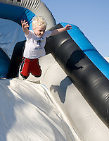 A kid jumps off on a bouncy slide at the Epicenter before the game at Buck Shaw Stadium in Santa Clara, California on August 11th, 2012.   Earthquakes defeated Sounders, 2-1.