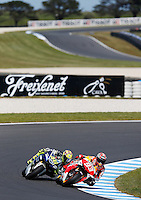Honda MotoGP rider Marc Marquez of Spain leads Yamaha MotoGP rider Valentino Rossi of Italy during the third practice session of the Australian Motorcycle GP in Phillip Island, Oct 19, 2013. Photo by Daniel Munoz/VIEWpress. IMAGE RESTRICTED TO EDITORIAL USE ONLY