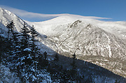 Mount Washington - Tuckerman Ravine in extreme weather conditions from Boott Spur Link Trail in the White Mountains, New Hampshire USA during the winter months. Strong winds cause snow to blow across the mountain tops.