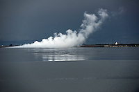 Steam rising from the mud flow epicentre. Since May 2006, more than 10,000 people in the Porong subdistrict of Sidoarjo have been displaced by hot mud flowing from a natural gas well that was being drilled by the oil company Lapindo Brantas. The torrent of mud - up to 125,000 cubic metres per day - continued to flow three years later.