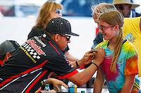 Jun 10, 2016; Englishtown, NJ, USA; NHRA top fuel driver J.R. Todd signs autographs during qualifying for the Summernationals at Old Bridge Township Raceway Park. Mandatory Credit: Mark J. Rebilas-USA TODAY Sports
