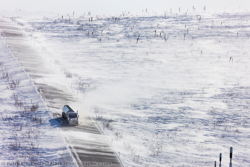 "Blowing snow across the James Dalton Highway near Finger Mountain, a notoriously winder area along the ""Haul Road"" that leads from Fairbanks to Prudhoe Bay, Alaska."