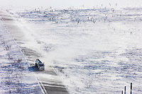 Blowing snow across the James Dalton Highway near Finger Mountain, a notoriously winder area along the &quot;Haul Road&quot; that leads from Fairbanks to Prudhoe Bay, Alaska.