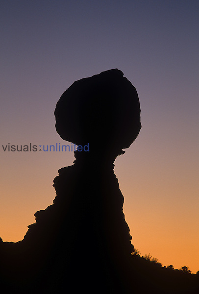 Balanced Rock silhouetted against the sunset sky, Arches National Park, Utah, USA.