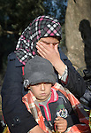 Heym Ali, a refugee from Daraa, Syria, weeps as she holds her son Abdalah, 5, on a beach near Molyvos, on the Greek island of Lesbos, on October 31, 2015. They were on a boat full of refugees that had just arrived from Turkey. They were received by local and international volunteers, then proceeded on their way toward western Europe. The boat was provided by Turkish traffickers to whom the refugees paid huge sums to arrive in Greece.