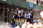 10 July 2015: Carli Lloyd (left) and Megan Rapinoe (right, holding the WWC Championship Trophy) and head coach Jill Ellis (behind, right). The United States Women's National Team was honored with a parade down New York City's Canyon of Heroes for winning the FIFA 2015 Women's World Cup in Canada.