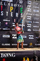 HONOLULU - (Friday, December 14, 2012) Joel Parkinson (AUS) celbrating his World Title win.-- The BILLABONG PIPE MASTERS In Memory of Andy Irons  concluded today in spectacular way. The 2012 ASP World Title was decided between Joel Parkinson (AUS) and Kelly Slater (USA) with Parkinson finally holding the World Title trophy above his head in front of thousands of surf fans..Slater was defeated by Josh Kerr (AUS) in the semi finals finishing his chance of winning a 12th World Title. Waves were  in the 6 to 8-feet for most of the day..Sebastien Zietz (HAW) won the 2012 Vans Triple Crown of Surfing title winning $100,000, a Harley Davidson motorcycle and a $10,000 Nixon watch..Photo: joliphotos.com