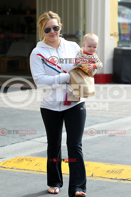 Already a Beatles fan? Hilary Duff had a relaxed Saturday and went out to get breakfast with baby Luca. Hilary opted for cozy sweatpants and zipper hoodie while cutie pie Luca wore cool Yellow Submarine pj's! Los Angeles, California on 25.08.2012..Credit: Correa/face to face.. /MediaPunch Inc. ***FOR USA ONLY*** ***Online Only for USA Weekly Print Magazines*** /NortePhoto.com<br />