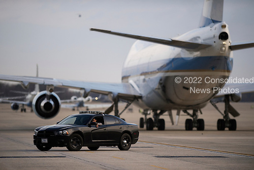 A military police officer sits in his car on the tarmac after Air Force One arrived, with United States President Barack Obama aboard, at Joint Base Andrews, Maryland, USA, 25 March 2016. President Obama returned on the over night flight from his trip to Cuba and Argentina.<br /> Credit: Shawn Thew / Pool via CNP