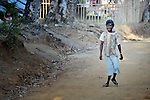 Leodi Donky walks down the street in Abucay, a seaside town in the Philippines province of Bataan. The 35-year old had childhood polio, and is a member of the local Persons with Disabilities (PWD) organization.