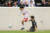 Irving Garcia (99) of the New York Red Bulls gets past a tackle by Stefani Miglioranzi (6) of the Philadelphia Union. The New York Red Bulls defeated the Philadelphia Union 2-1 during a US Open Cup qualifier at Red Bull Arena in Harrison, NJ, on April 27, 2010.