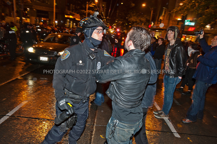 11/2/2011--Seattle, WASH., USA..Several hundred demonstrators from Occupy Seattle headed downtown and marched to the Sheraton Hotel where JPMorgan Chase CEO Jamie Dimon was invited to speak Wednesday night. Dimon was a speaker at a University of Washington Foster School of Business leadership celebration...Here protesters confront police outside the Sheraton Hotel...©2011 Stuart Isett. All rights reserved