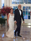 Washington Post Columnist Eugene Robinson and Mrs. Avis Robinson arrive at the State Dinner for China's President President Xi and Madame Peng Liyuan at the White House in Washington, DC for an official State Visit Friday, September 25, 2015. Credit: Chris Kleponis / CNP