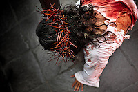 A Peruvian actor Mario Valencia, performing as Jesus Christ, kneels on the ground in the Good Friday procession during the Holy week in Lima, Peru, 30 March 2013. The annual Passion Of Christ procession, held as part of Easter celebrations, starts in Lima downtown and, followed by thousands of catholic believers, it climbs to the top of the dry and rocky hill of San Cristobal, where Mario Valencia, who has been playing the role of Jesus Christ for more than 30 years, is symbolically crucified.
