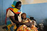 Asha Ibrahim Musa sits with her 23 month old son, Alyas Adam, in a ward for malnourished children in a hospital in Garsila. The children, all displaced by Darfur's ethnically-motivated violence, receive therapeutic feeding here. The ward is supported by the ACT-Caritas Darfur Emergency Response, a joint response of the world's Protestant and Catholic communities to the humanitarian crisis in Darfur.