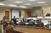 Sniper suspect John Allen Muhammad, left seated, listens as defense attorney Peter Greenspun, standing, addresses the court during his trial in the Virginia Beach Circuit Court in Virginia Beach, Virginia on November 12, 2003. <br /> Credit: Lawrence Jackson - Pool via CNP