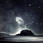 Composing of a seascape with parts of a stellar nebula as sky. <br />