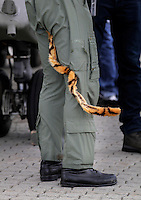 A British helicopter pilot with a tiger tail on his uniform during Tiger Air show.  Nato Tiger Meet is an annual gathering of squadrons using the tiger as their mascot. While originally mostly a social event it is now a full military exercise. Tiger Meet 2012 was held at the Norwegian air base &Oslash;rlandet.