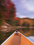 Canoeing on lake George in beautiful fall nature scenery. Killarney Provincial Park, Ontario, Canada.