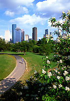 Stock photo of a man bicycling on a hike and bike path at Buffalo Bayou Park near downtown Houston.