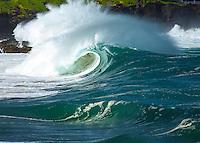 A large hollow wave breaking at Waimea Shorebreak in Waimea Bay on the North Shore of O'ahu
