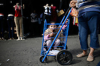 Diana Ruacho, 4, and her mother, Francisca Ruacho, of French Camp wander the Galt Flea Market looking for bargains while enjoying ice cream and churros on Feb. 20, 2008.