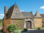 """Old house in Meyrals, Périgord, featuring """"pierres de causse"""" limestone roof characteristic of the region. The stones are not cemented but are supported by a latticework of wood beams. The roof needs to be very pointed and high to support the enormous weight of the stones."""