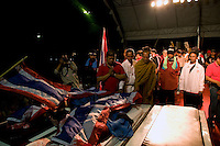 """The bodies of two """"Red Shirt"""" protesters are displayed on the stage erected at the Phan Fah bridge in central Bangkok. They were allegedly kille by the military who opened fire before retreating."""
