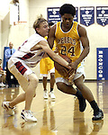 Bay Area Christian's Ben Rose #11 tries to steel the ball from Mt. Carmel's Genero Wade, #24 during the game, 01/21/05.    (Photo by Kim Christensen)