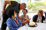 Mary Caulfield is presented with a birthday cake by her son Seamus in the tent during the Caulfield family reunion at the Caulfield home in Granlahan, County Roscommon, Ireland on Tuesday, June 25th 2013. (Photo by Brian Garfinkel)