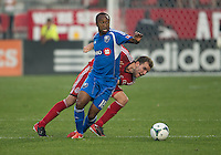 03 July 2013: Montreal Impact midfielder Collen Warner #18 and Toronto FC forward Jeremy Brockie #22 in action during an MLS game between the Montreal Impact and Toronto FC at BMO Field in Toronto, Ontario Canada.<br /> The game ended in a 3-3 draw.