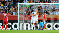 Lauren Cheney (r) and Carli Lloyd of team USA celebrate during the FIFA Women's World Cup at the FIFA Stadium in Dresden, Germany on June 28th, 2011.