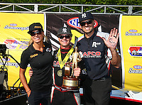 Jun 12, 2016; Englishtown, NJ, USA; NHRA top fuel driver Steve Torrence (center) celebrates with Leah Pritchett (left) and crew member Gary Pritchett after winning the Summernationals at Old Bridge Township Raceway Park. Mandatory Credit: Mark J. Rebilas-USA TODAY Sports