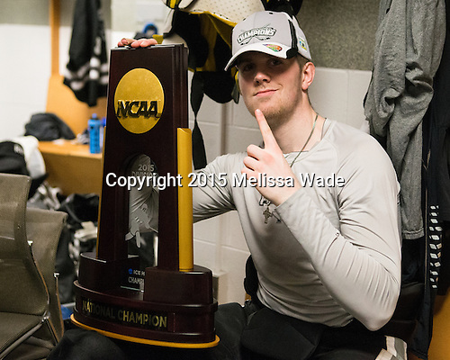 Mark Adams (PC - 4) - The Providence College Friars celebrated their national championship win after the Frozen Four final at TD Garden on Saturday, April 11, 2015, in Boston, Massachusetts.