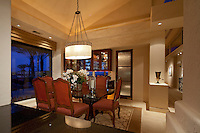 Elegant dining room is shown in modern design home at night