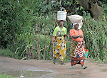 Women walking along a street in the Congolese town of Kananga.