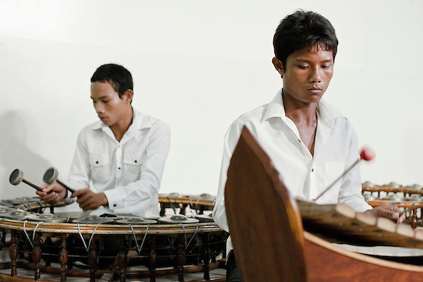 """Pinpeat Music Class at Cambodia Living Arts House. Phnom Penh, Cambodia. Right: The Roneat Thoung is a tuned percussion instrument made of wood. This instrument plays an important part in the """"Pin Peat"""" and """"Mohowrri"""" orchestras. ..Left: Korng Thomm:( aka Kong vong toch )A small gong circle from Cambodia...Cambodian Living Arts works to support the revival of traditional Khmer performing arts and to inspire contemporary artistic expression. CLA supports arts education, mentorship, networking opportunities, education, career development, and income generating projects for master performing artists who survived the Khmer Rouge as well as the next generation of student artists."""