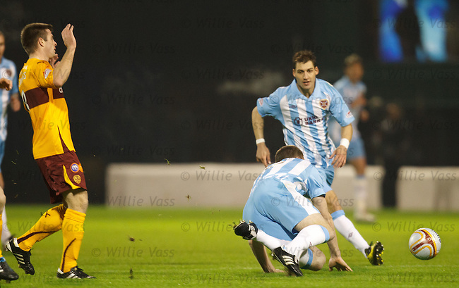 Steve Jennings takes out Kevin Kyle early in the first half to earn his first booking of the evening