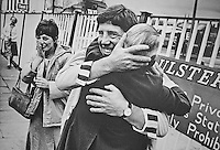 Sean Smyth, one of the Maguire Seven, is reunited with his father, John, at Glengall St bus station, Belfast, N Ireland, following his release from a prison in England. His tearful sister Kathy Smyth is also in the photo. The Maguire Seven were charged with possessing nitroglycerine for the IRA following a police raid on Annie Maguire's house in West Kilburn, London, UK, on 3 December 1974. Sean Smyth is Annie Maguire's brother. The Maguire Seven's convictions were quashed in 1991. 198300006543.<br />